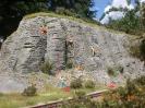 Kletterer haben eine Felswand erobert